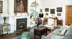 Gardening guru Helen Dillon with her husband Val and their two adored dachhunds, Ruby and Rosie, in their gorgeous barrel-vaulted living room designed by architect Michael Kelly. Though it's large, it's cosy thanks to the gas fire and underfloor heating. Photo: Tony Gavin