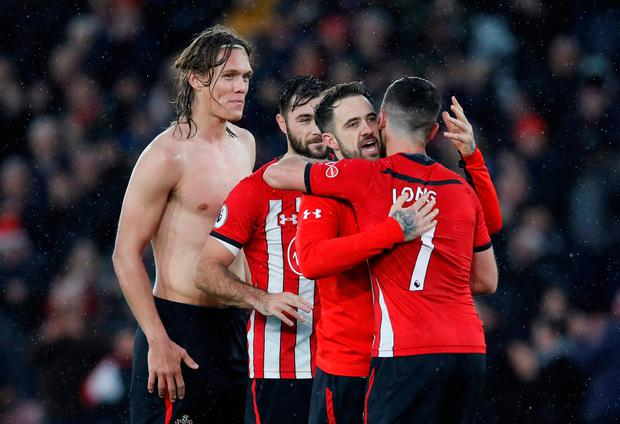 Soccer Football - Premier League - Southampton v Arsenal - St Mary's Stadium, Southampton, Britain - December 16, 2018 Southampton's Danny Ings celebrates with Shane Long, Charlie Austin and Jannik Vestergaard at the end of the match REUTERS/David Klein
