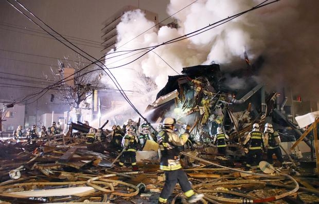 Firefighters operate at the site where a large explosion occurred at a restaurant in Sapporo, Hokkaido, northern Japan, in this photo taken by Kyodo December 16, 2018. Photo: Kyodo/via REUTERS