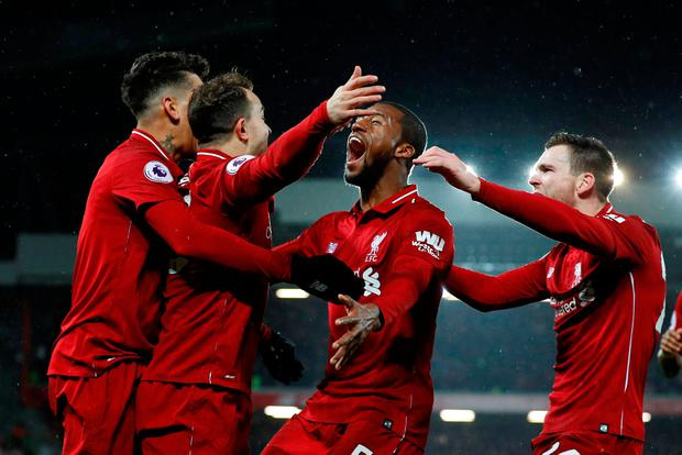Soccer Football - Premier League - Liverpool v Manchester United - Anfield, Liverpool, Britain - December 16, 2018 Liverpool's Xherdan Shaqiri celebrates scoring their second goal with Georginio Wijnaldum and team mates REUTERS/Phil Noble