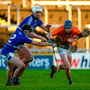 Ciaran Wheelan of Carlow in action against Donnacha Hartnett of Laois. Photo by Eóin Noonan/Sportsfile