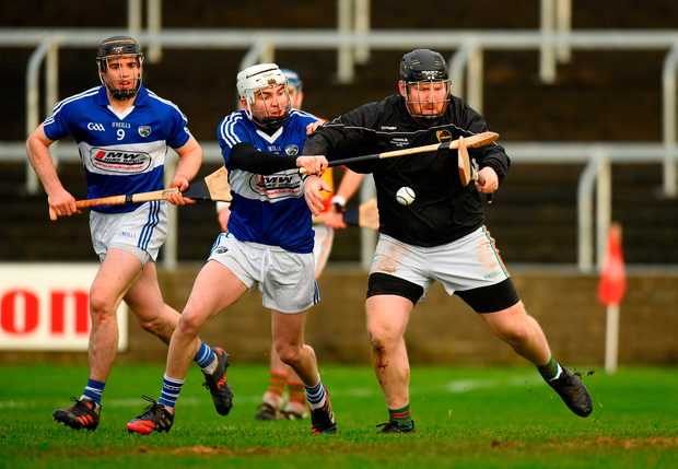 Brian Tracey of Carlow in action against Stephen Bergin of Laois. Photo by Eóin Noonan/Sportsfile