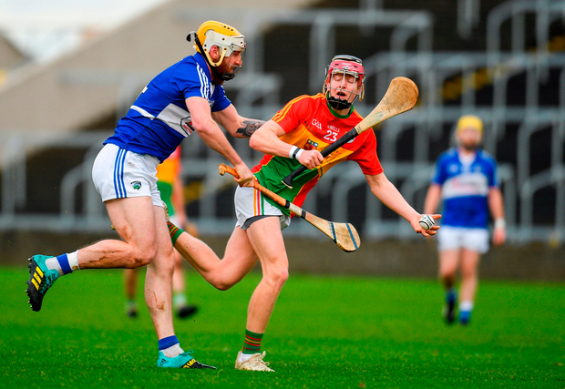 Jon Nolan of Carlow in action against Leigh Bergin of Laois. Photo by Eóin Noonan/Sportsfile