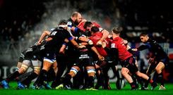 Castres' Rory Kockott waits for the ball to come out of the scrum during his side's clash with Munster. Photo: Brendan Moran/Sportsfile
