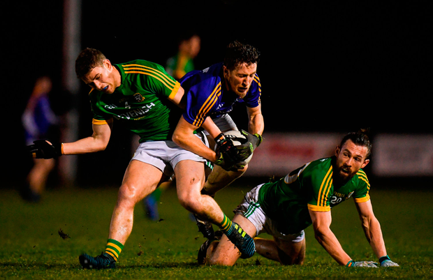 Daniel Mimnagh of Longford in action against Shane Gallagher, left, and Eoin Lynch of Meath. Photo by Harry Murphy/Sportsfile