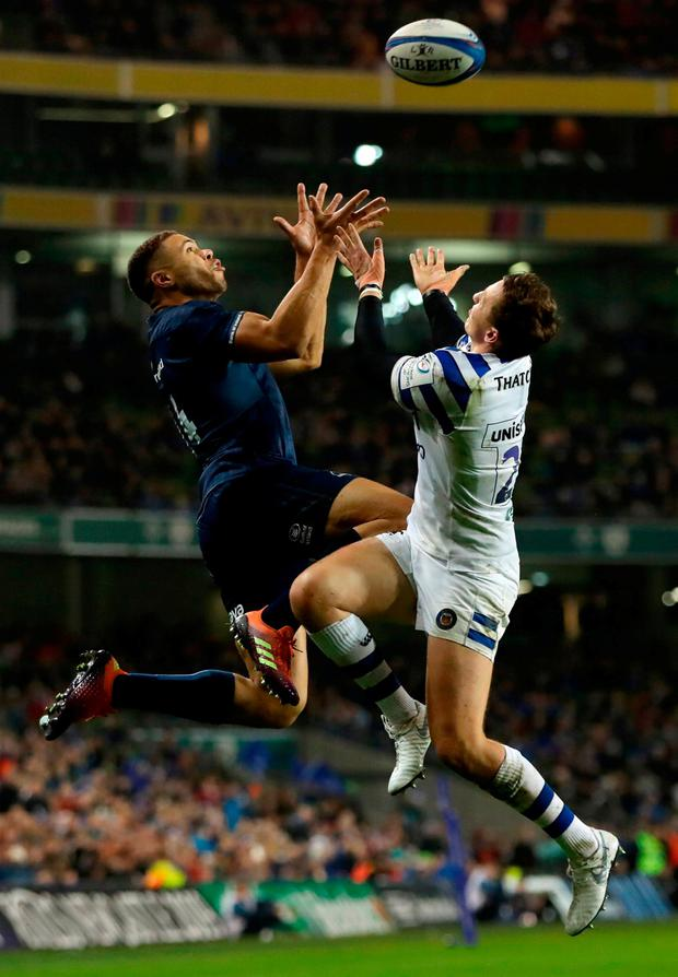 Adam Byrne wins the aerial duel ahead of Bath's Darren Atkins in the build-up to Leinster's fourth try. Photo: David Rogers/Getty Images