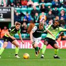 Daryl Horgan gets past Celtic's Olivier Ntcham and James Forrest during Hibernian's 2-0 win at Easter Road yesterday. Photo: PA
