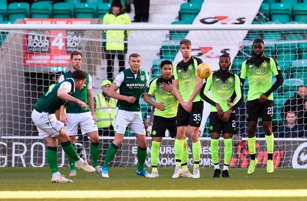 Stevie Mallan curls a free kick over the Celtic wall. Photo: PA