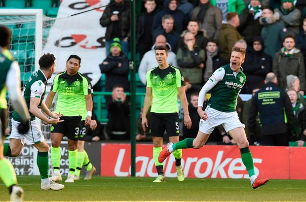 Vykintas Slivka celebrates after putting Hibs in the lead. Photo: PA
