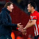 Saints on march: Manager Ralph Hasenhuttl celebrates with Japanese defender Maya Yoshida after the match. Photo: AFP/Getty Images