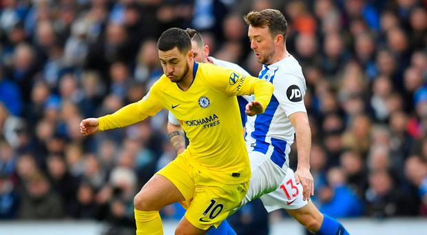 Eden Hazard leaves Brighton's Dale Stephens trailing in his wake. Photo: REUTERS/Toby Melville