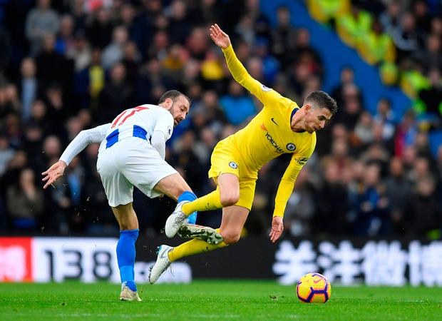 Chelsea's Jorginho goes to ground after a tackle from Glenn Murray. Photo: REUTERS/Toby Melville