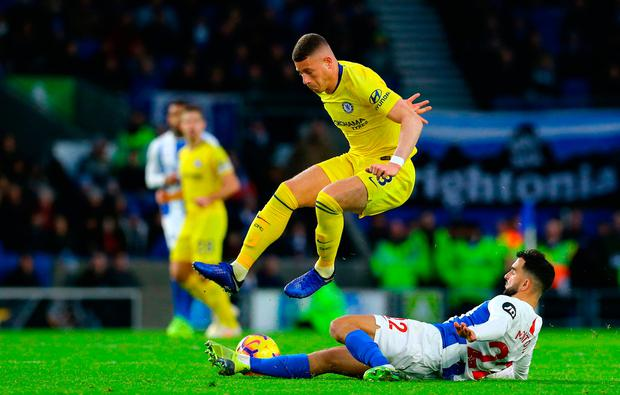 Chelsea's Ross Barkley leaps over a challenge from Martin Montoya. Photo: Gareth Fuller/PA Wire