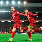 Xherdan Shaqiri celebrates with Roberto Firmino (R) after scoring Liverpool's third goal during their victory over Manchester United at Anfield. Photo: AFP/Getty Images