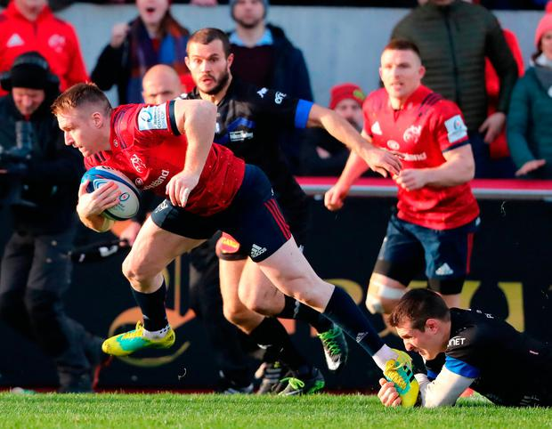 Close encounter: Rory Scannell gets away from a foot tackle to score a try for Munster. Photo: Niall Carson/PA Wire