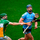 John Hetherton of Dublin comes under pressure from Offaly's Tom Spain (left). Photo by Harry Murphy/Sportsfile