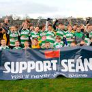 Support: Players from St Peter's, Dunboyne, and Round Towers, Clondalkin, show their support for Sean Cox before the match between Dublin and Meath. Photo: Caroline Quinn