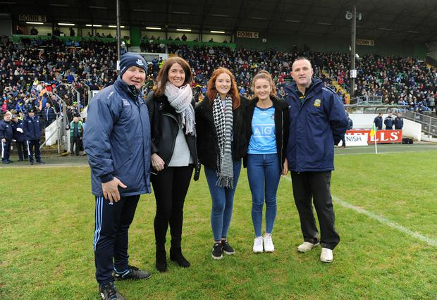 Managers Jim Gavin and Andy McEntee with Martina Cox and daughters Emma and Shauna. Photo: Caroline Quinn