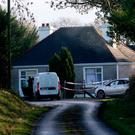 Probe: Gardaí at the house at Strokestown. Photo: Brian Farrell