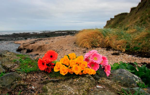 Flowers at Bell's Beach where a baby girl's body was discovered in Balbriggan North County Dublin. Photo: Gareth Chaney Collins