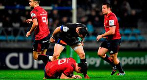 15 December 2018; Thomas Combezou of Castres Olympique stands over Joey Carbery of Munster after a tackle during the Heineken Champions Cup Pool 2 Round 4 match between Castres and Munster at Stade Pierre Fabre in Castres, France. Photo by Brendan Moran/Sportsfile