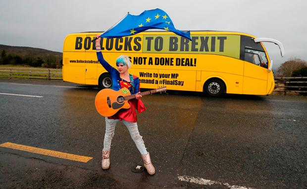 Opposition: EU 'Supergirl' Madeleina Kay stands in front of the anti-Brexit campaign bus in Co Louth. Photo: Niall Carson/PA Wire