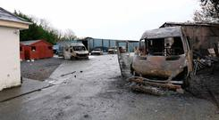 Crime scene: burned out vehicles at the home where security guards were attacked. Photo: Frank McGrath