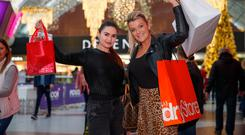 In the bag: Milly Nilaj and Niamh Garrahan, both from Dublin, hit the high street on Black Friday, but most sought bargains online. Photo: Mark Condren