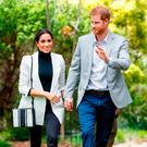 Expecting: Meghan Markle and her husband Prince Harry during a recent tour of Australia. Photo: PA