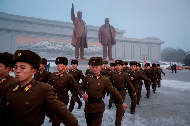 Korean People's Army (KPA) soldiers leave after bowing before the statues of late North Korean leaders Kim Il Sung and Kim Jong Il during National Memorial Day on Mansu Hill in Pyongyang. Photo: AFP/Getty Images