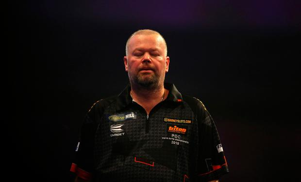 Raymond van Barneveld reacts during his first round defeat to Darius Labanauskas last night. Photo: PA