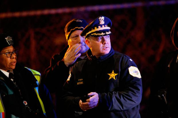 Police officers work the scene where two officers were killed after they were struck by a South Shore train near 103rd Street and Dauphin Avenue on Monday, Dec. 17, 2018, in Chicago. (Armando L. Sanchez/Chicago Tribune via AP)