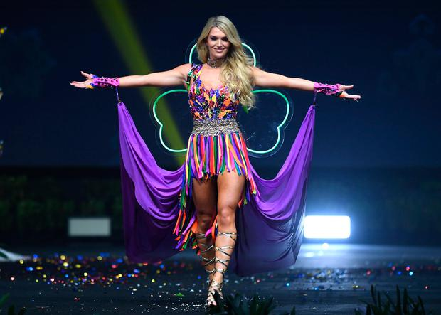 Grainne Gallanagh, Miss Ireland 2018 walks on stage during the 2018 Miss Universe national costume presentation in Chonburi province on December 10, 2018. (Photo by Lillian SUWANRUMPHA / AFP)