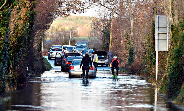 Flooded: Motorists are confronted by a flooded road between Killarney and Killorglin following overnight torrential rain in Kerry. Photo: Don MacMonagle