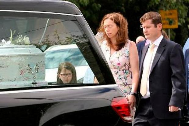 Grief: Liam and Lisa Marren follow the hearse carring the remains of son Cian in 2017.