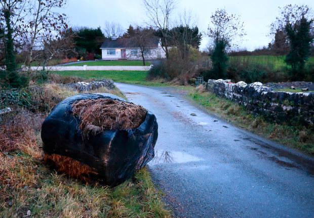 One of the bales of hay which was used to block a bridge on the night of the attack on eight security men at the property.