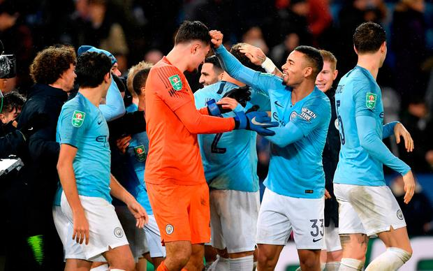 Manchester City players celebrate with goalkeeper Arijanet Muric (centre) as they win 3-1 in the penalty shoot out. Photo: PA