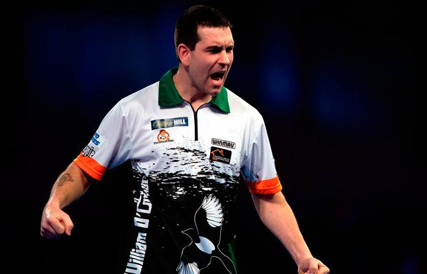 William O'Connor celebrates during his match against Yordi Meeuwisse during day four of the William Hill World Darts Championships at Alexandra Palace, London. Sunday December 16, 2018.