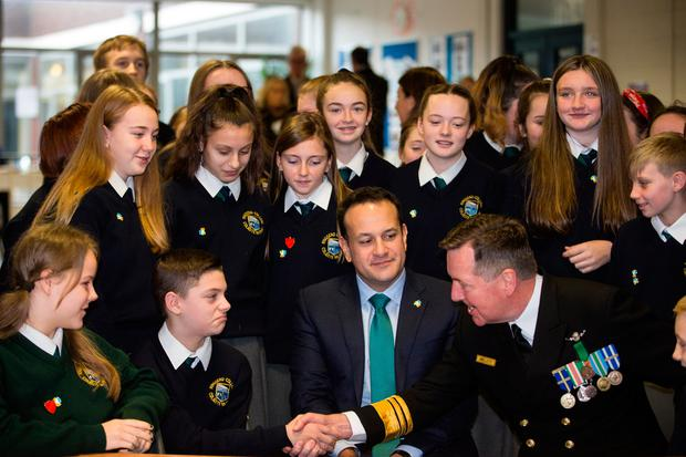 Pleased to meet you: Taoiseach Leo Varadkar and Vice Admiral Mark Mellett DSM, Chief of Staff of the Defence Forces, meet students during their visit to Ringsend School, Dublin, as they launched the Global Schools programme yesterday. Photo: Mark Condren