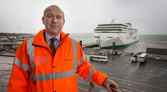 In the eye of a storm: Glenn Carr, Rosslare Europort manager, pictured in front of the WB Yeats ferry at Rosslare yesterday. Photo: Colin O'Riordan