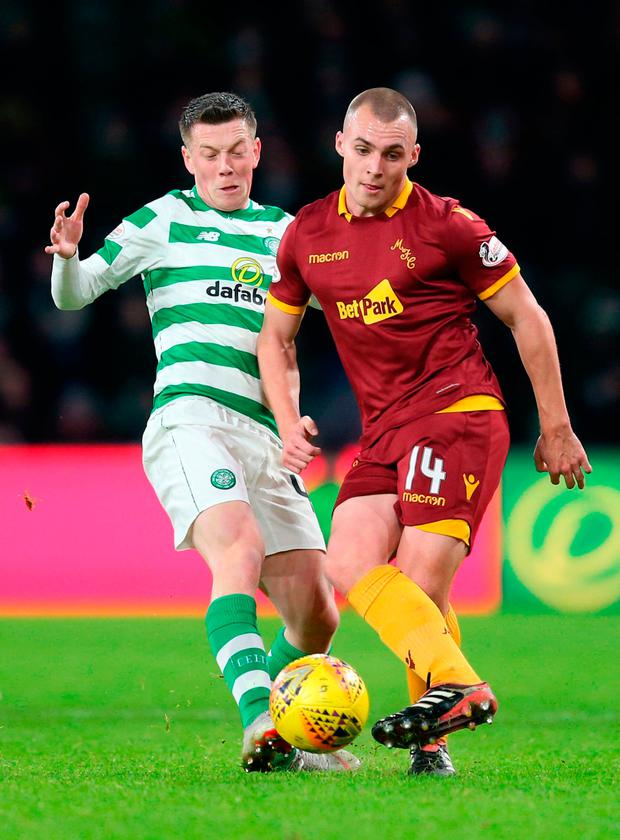 Celtic's Callum McGregor and Motherwell's Liam Grimshaw battle for the ball. Photo: Jane Barlow/PA Wire