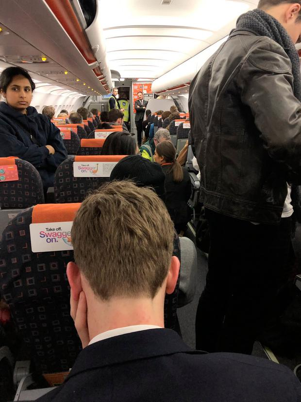 Picture taken with permission from the Twitter feed of Luke Mccomiskie showing the scene inside a plane three hours after it landed at Manchester having been diverted from Gatwick Airport which had been closed because of the sighting of drones. Photo: Luke Mccomiskie/PA Wire
