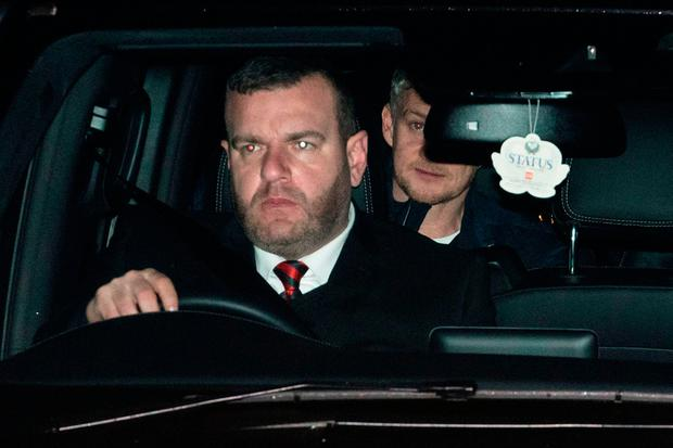 Manchester United's Ole Gunnar Solskjaer (C) is driven in to the club's Carrington Training complex in Manchester