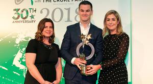 Johnny Sexton, Ireland rugby international, is presented with the Sports Moment of the Year award from Muireann King, Director of Sales and Marketing, Croke Park Hotel, and Arlene Regan, Brand Manager, Irish Independent at the Irish Independent Sportstar of the Year Awards at Croke Park. Picture credit; Damien Eagers / INM