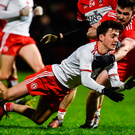 Darragh Canavan of Tyrone in action against Eoghan Concannon of Derry. Photo: Sportsfile