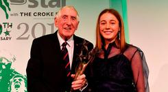 Sarah Healy is presented with the Young Sportstar of the Year Award by Olympic gold medal winner Ronnie Delany. Photo: Sam Barnes/Sportsfile
