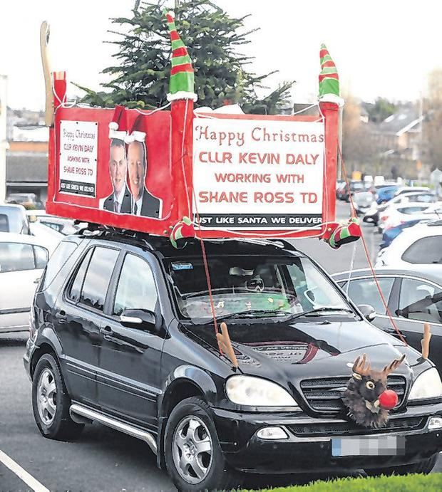 Controversy: Councillor Kevin Day's car with the sleigh and Christmas tree on top of it. Photo: Justin Farrelly.