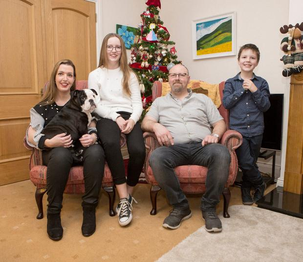 New arrival: From left is Vicky with new family member Alfie, Amelia, husband Jim, and son Darragh at home. Photo: Liam Burke