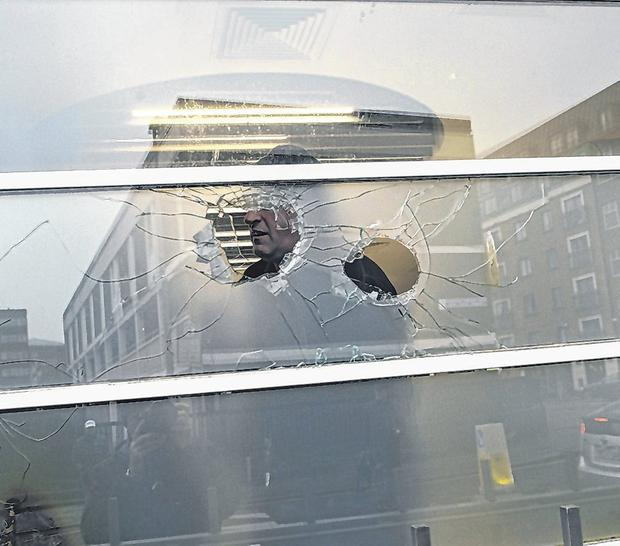 Damage: Holes in a window at the KBC bank offices in Dublin which were set on fire on Thursday night