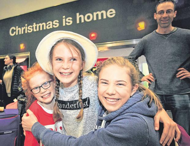 Robyn (8) and Molly Scott (13) greet their cousin Eve-Lily (11) from Sydney